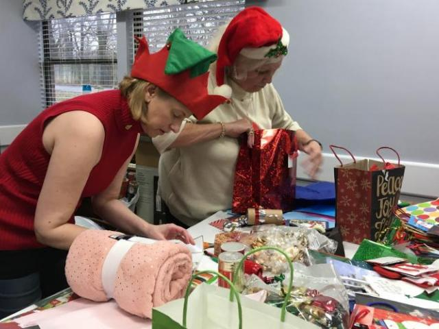 Homemakers wrapping and bagging gifts